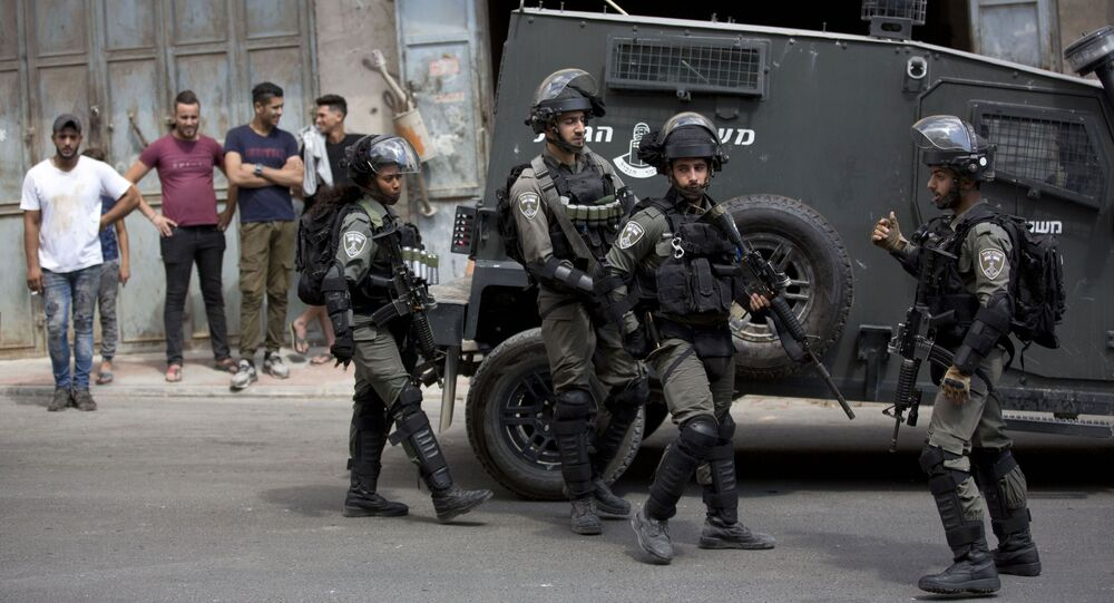 Israeli border police officers, stand in the village of Azzun near the West Bank city of Qalqilya