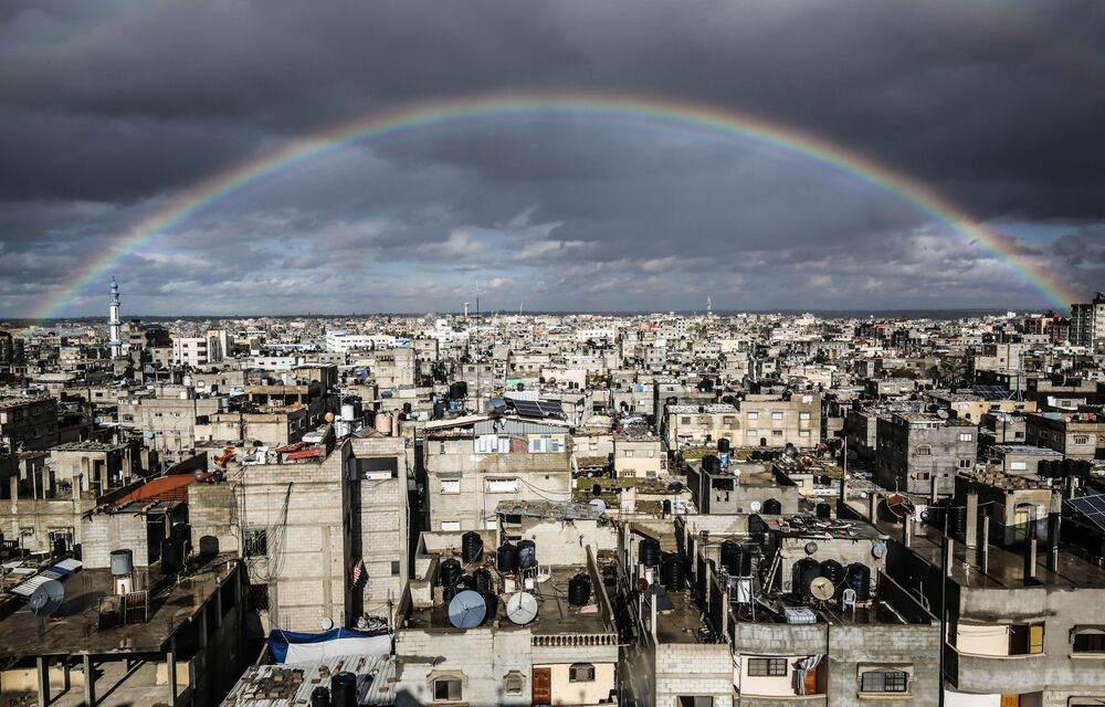 A rainbow in the sky above Rafah on a rainy day at sunset in the southern Gaza Strip.