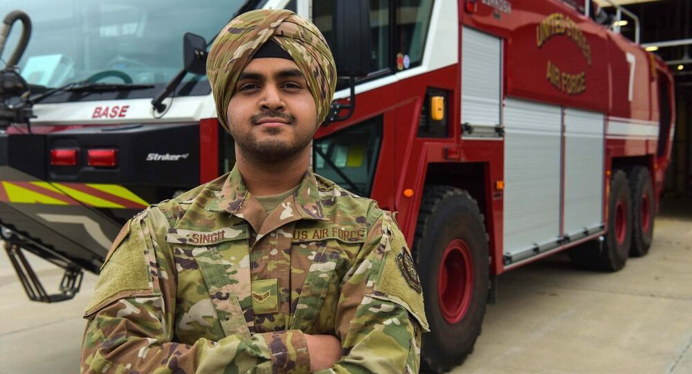 Airman 1st Class Jaspreet Singh, the first Airman at Joint Base McGuire-Dix-Lakehurst to wear a U.S. Air Force approved turban as a uniform item stands in front of a fire truck at Fire Station 1, Joint Base MDL, Dec. 5, 2019