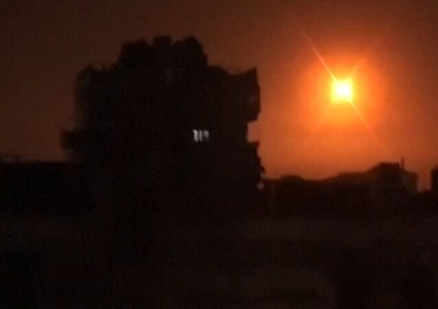 An image grab obtained from handout footage released by the official Syrian Arab News Agency (SANA) on February 14, 2020, reportedly shows footage of Syrian air defence firing into the sky and exploding during a reported Israeli missile attack near Damascus