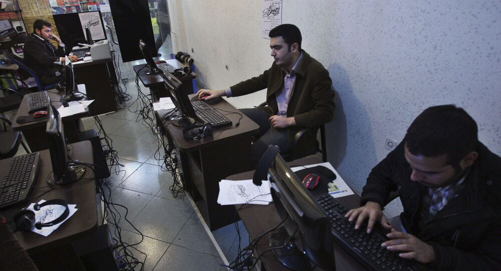 Iranian journalism students work at an internet cafe in central Tehran, Iran, Tuesday, Jan. 18, 2011