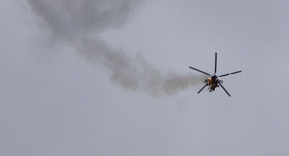 Syrian government helicopter is shot by a missile in Idlib province, Syria, Tuesday, Feb. 11, 2020