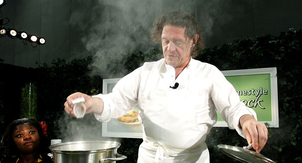 World-renowned Chef Marco Pierre White is seen during a cooking class with leading bloggers at the 2011 BlogHer Conference using his secret ingredient; new Knorr (R) Homestyle Stock at the San Diego Convention Center on Saturday Aug. 6, 2011 in San Diego