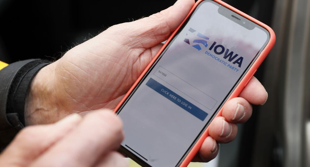 Precinct captain Carl Voss of Des Moines displays the Iowa Democratic Party caucus reporting app on his phone outside of the Iowa Democratic Party headquarters in Des Moines, Iowa, Tuesday, Feb. 4, 2020