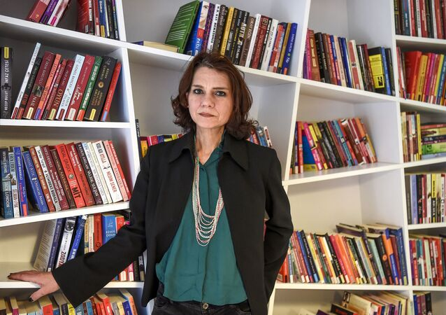 In this file photo taken on February 08, 2017 Turkish novelist Asli Erdogan poses during an interview in Istanbul.