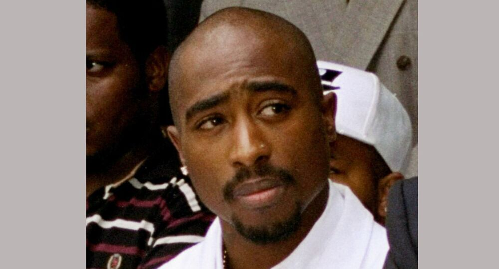 FILE - In this Aug. 15, 1996, file photo, rapper Tupac Shakur attends a voter registration event in South Central Los Angeles