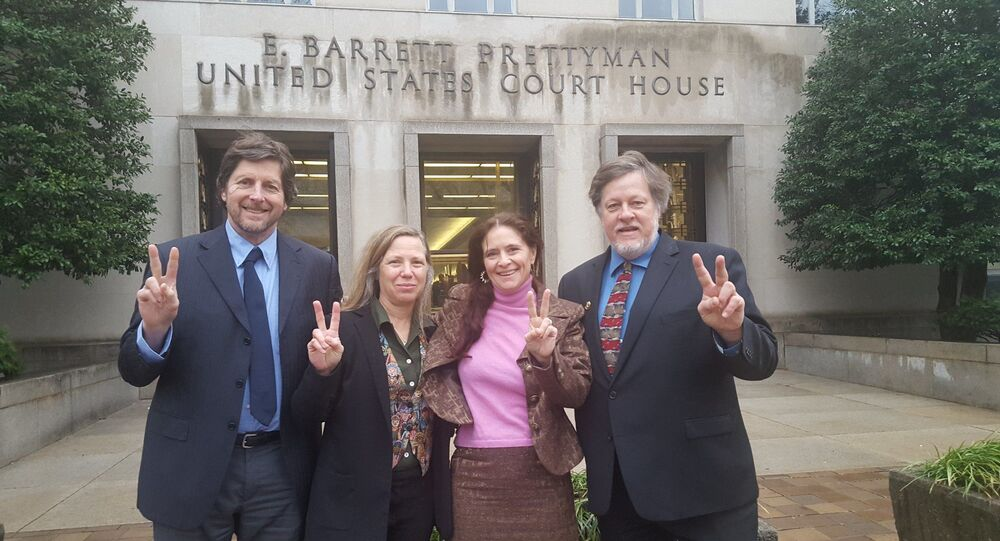 The Embassy Protection Collective Four outside the US courthouse prior to their February 2020 trial. Left to right: David Paul, Margaret Flowers, Adrienne Pine, and Kevin Zeese.