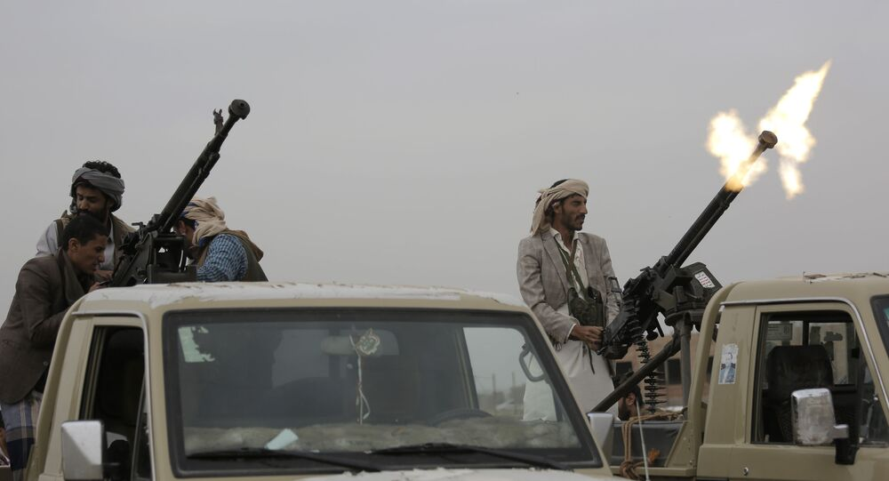 A Houthi rebel fighter fires in the air during a gathering aimed at mobilizing more fighters for the Houthi movement, in Sanaa, Yemen