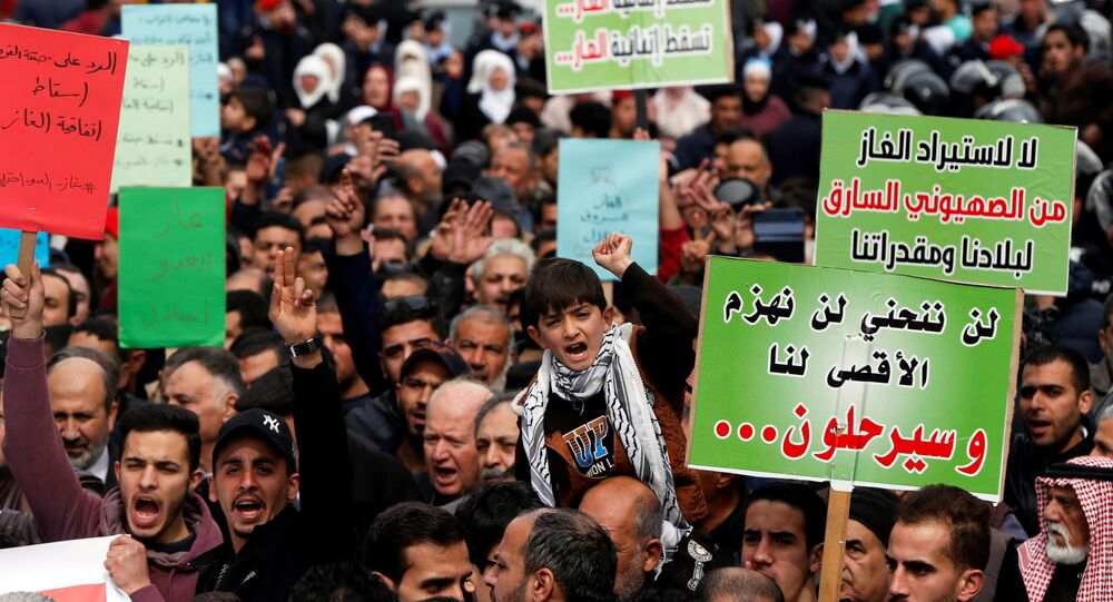 People shout slogans during a protest against U.S. President Donald Trump's proposed Middle East peace plan, and a government's agreement to import natural gas from Israel, in Amman, Jordan, February 14, 2020