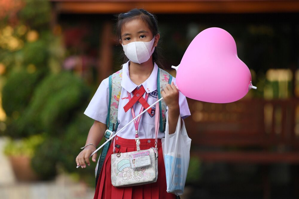 A girl arrives at a school wearing a protective face mask on Valentine's Day in Ayutthaya, outside Bangkok, Thailand February 14, 2020.