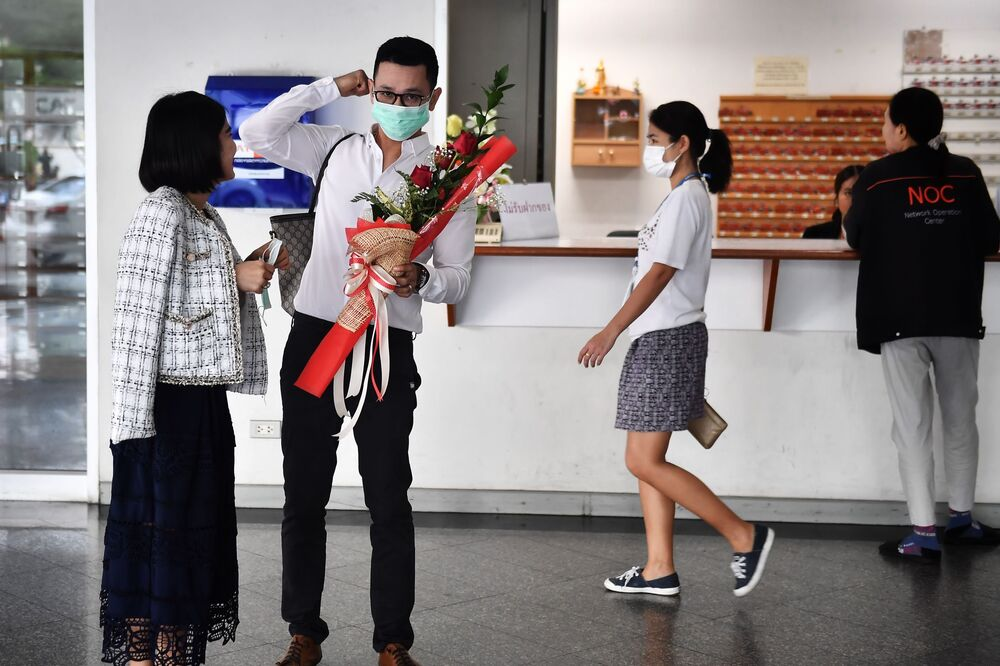 A couple in protective facemasks prepare to register their marriage licence on Valentine's Day in Bang Rak, the Thai capital's district of love, in Bangkok on February 14, 2020.