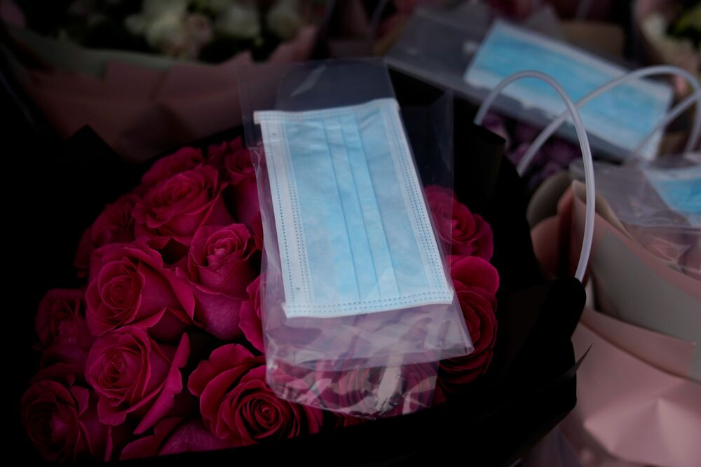 A bouquet of roses being sold with a face mask is seen at a florist on Valentine's Day, as the country is hit by an outbreak of the novel coronavirus, in Shanghai, China February 14, 2020.