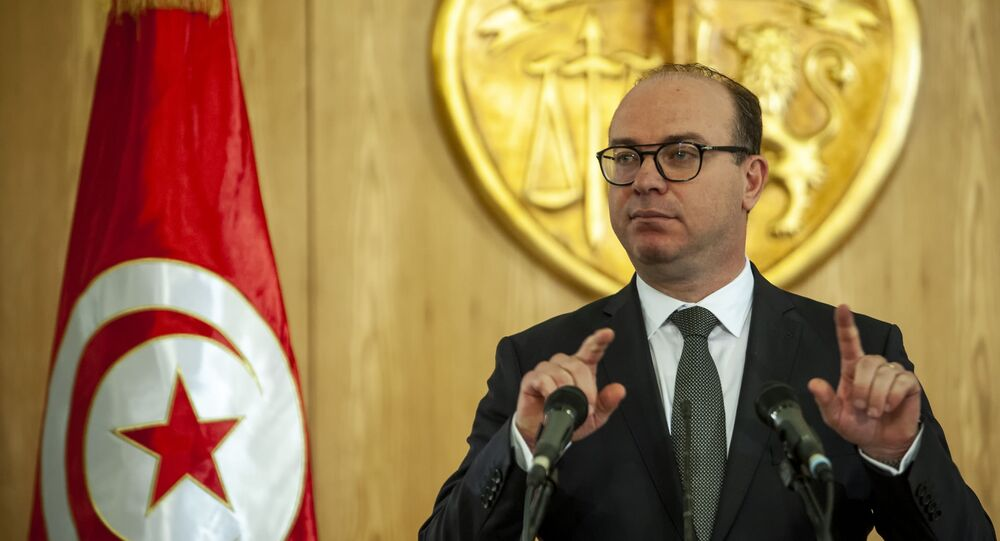Prime Minister-designate Elyes Fakhfakh speaks during a press conference in Tunis