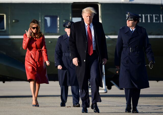 U.S. President Donald Trump and first lady Melania Trump walk from Marine One to board Air Force One as they depart Washington for travel to Florida at Joint Base Andrews, Maryland, U.S., February 14, 2020.