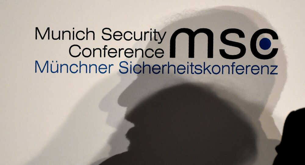 The shadow of Iranian Foreign Minister Mohammad Javad Zarif is seen as he speaks on the second day of the Munich Security Conference
