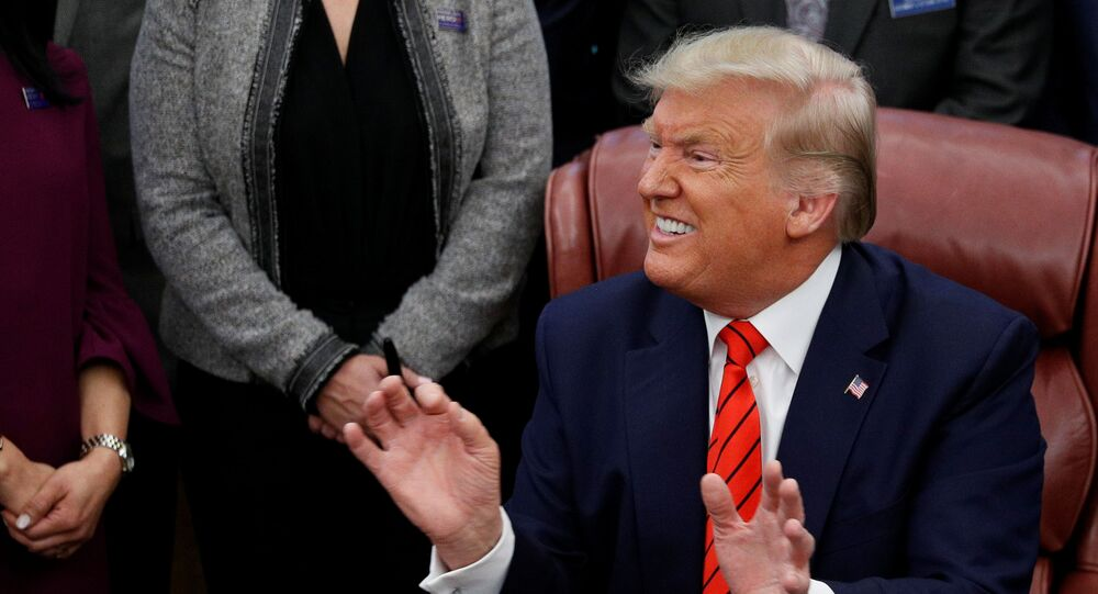 U.S. President Donald Trump reacts to a question from a reporter