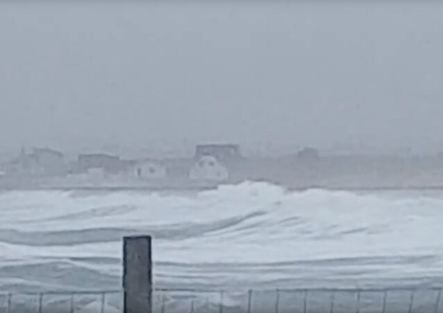 Large waves caused by storm Dennis are seen near Stornoway, Scotland