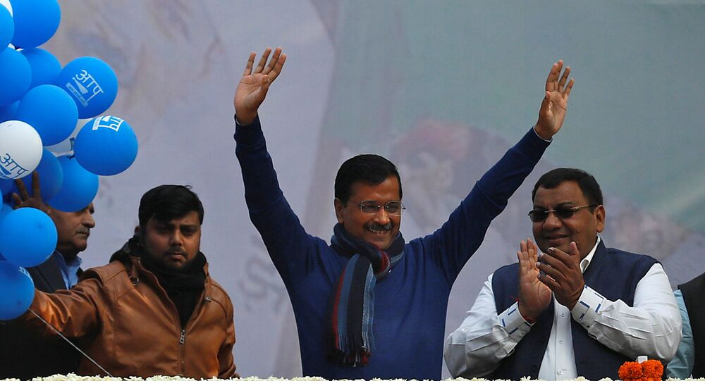 Delhi Chief Minister and leader of Aam Aadmi Party (AAP) Arvind Kejriwal waves to his supporters