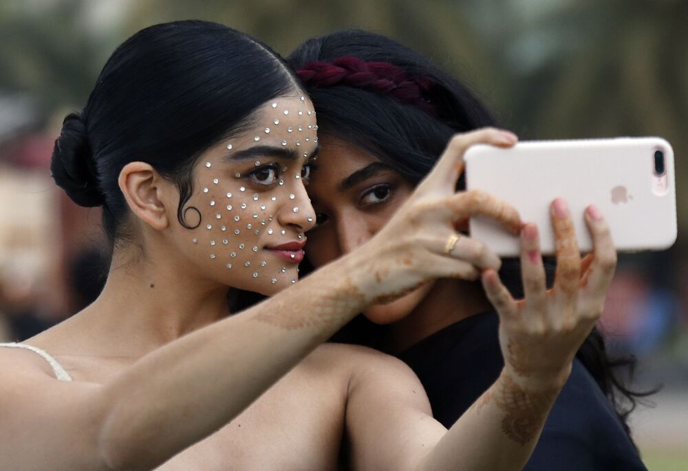 Models take a selfie during the Lakme Fashion Week in Mumbai, India, Friday, Feb. 14, 2020.