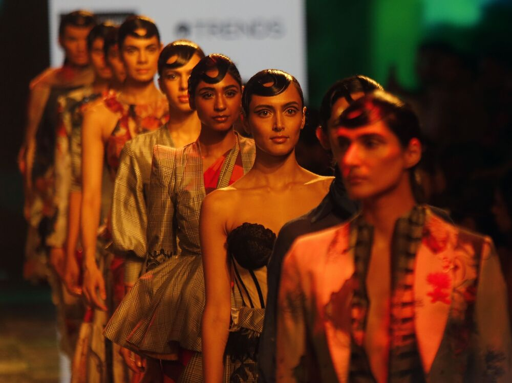 Models walk the ramp to showcase the creations of House of Three X Tantajo during Lakme fashion week in Mumbai, India, Thursday, Feb. 13, 2020.