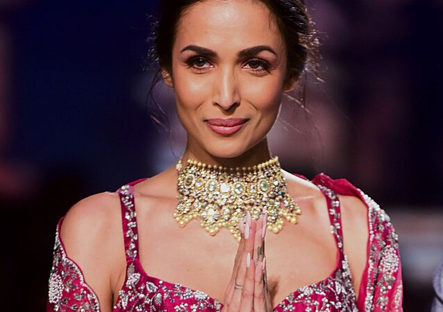 Bollywood actress Malaika Arora  presents a creation by Varun Chkkilam during the Lakme Fashion Week 2020 Summer/Resort fashion show in Mumbai on February 14, 2020.