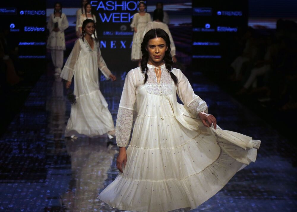 Models walk the ramp to showcase the creations of Buna during Lakme fashion week in Mumbai, India, Thursday, Feb. 13, 2020.