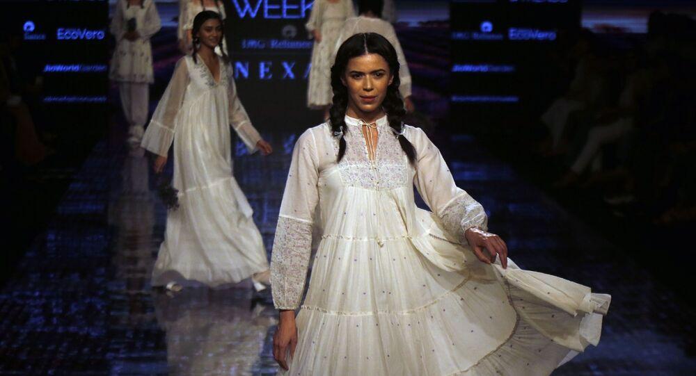 Models walk the ramp to showcase the creations of Buna during Lakme fashion week in Mumbai, India, Thursday, Feb. 13, 2020.