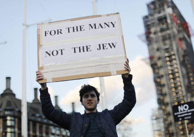 Members of the Jewish community hold a protest against Britain's opposition Labour party leader Jeremy Corbyn and anti-semitism in the  Labour party, outside the British Houses of Parliament in central London on March 26, 2018.