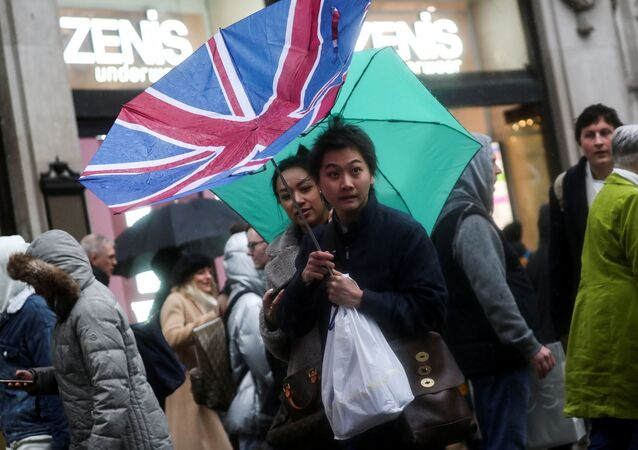 A pedestrian's Union flag umbrella is turned inside out by the wind at Oxford Street during Storm Dennis in London, Britain February 16, 2020.
