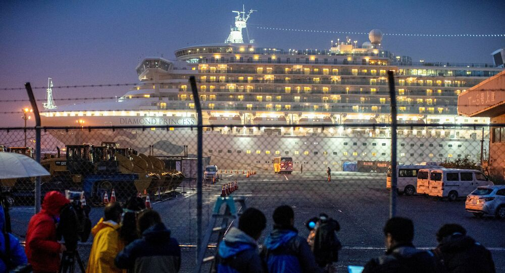 A bus arrives near the cruise ship Diamond Princess, where dozens of passengers were tested positive for coronavirus