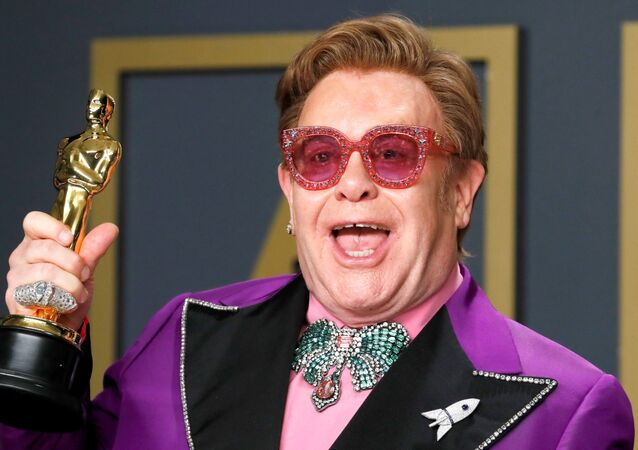 Elton John poses with the Oscar for Best Original Song for (I'm Gonna) Love Me Again from Rocketman in the photo room during the 92nd Academy Awards in Hollywood, Los Angeles, California, U.S., February 9, 2020.