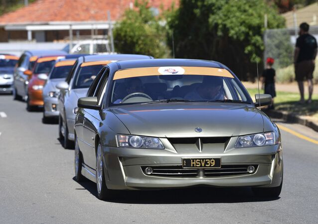 Holden cars parade through the streets of Adelaide, Australia