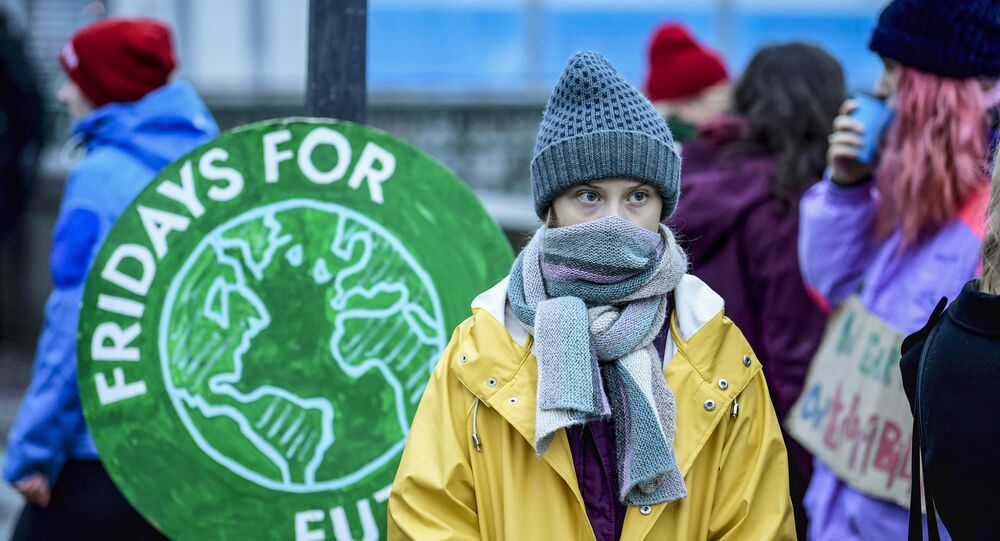 Swedish environmental activist Greta Thunberg attends a climate strike arranged by the organisation Fridays For Future outside the Swedish parliament Riksdagen in Stockholm, December 20, 2019. (Photo by Pontus LUNDAHL / TT News Agency / AFP) / Sweden OUT