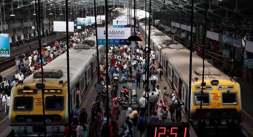 Commuters disembark from suburban trains at Churchgate railway station in Mumbai, India, February 1, 2020.