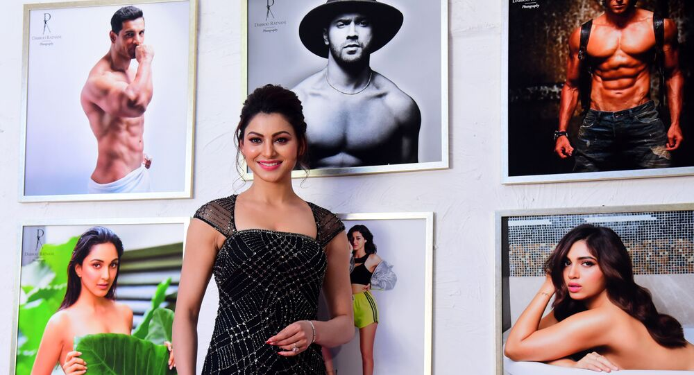 In this picture taken on February 17, 2020, Bollywood actress Urvashi Rautela poses for a picture during the launch of photographer Dabboo Ratnani's 2020 calendar, in Mumbai.