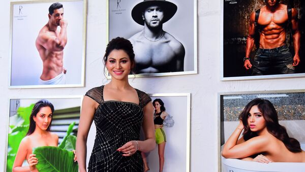 In this picture taken on February 17, 2020, Bollywood actress Urvashi Rautela poses for a picture during the launch of photographer Dabboo Ratnani's 2020 calendar, in Mumbai.  - Sputnik International