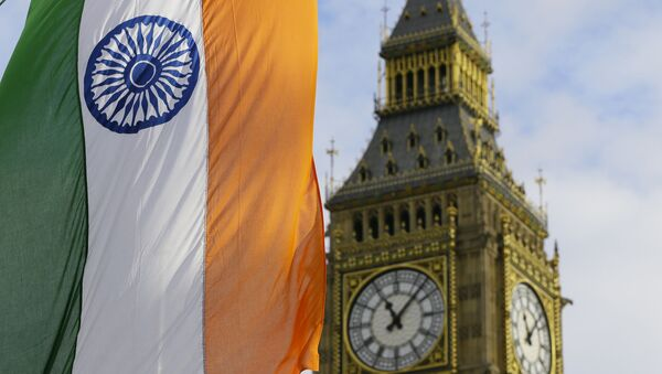 An Indian Flag hangs near the London landmark Big Ben in Parliament Square in London, Thursday, Nov. 12, 2015. Indian Prime Minister Narendra Modi is in Britain for a three day visit. - Sputnik International