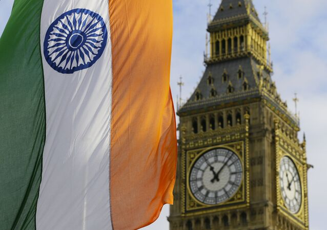 An Indian Flag hangs near the London landmark Big Ben in Parliament Square in London, Thursday, Nov. 12, 2015. Indian Prime Minister Narendra Modi is in Britain for a three day visit.