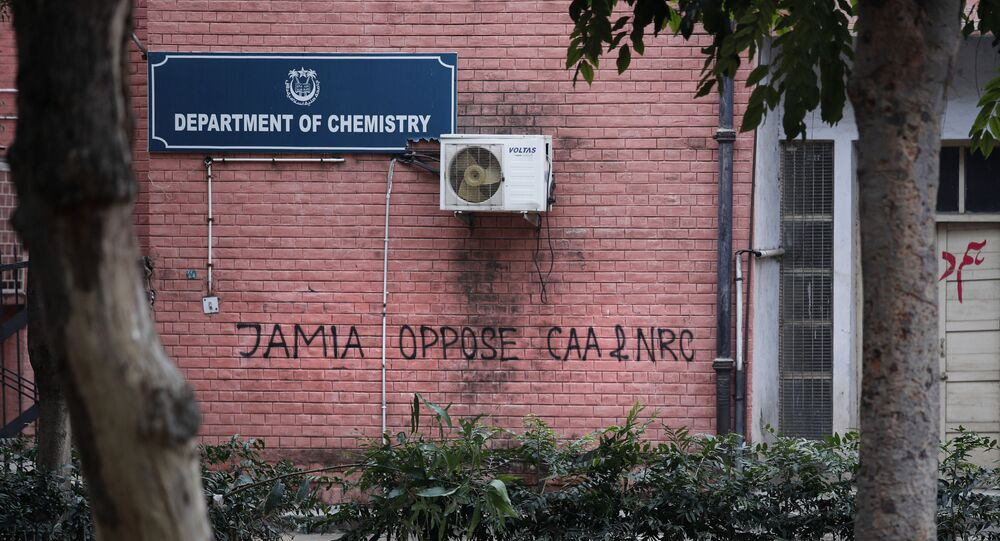 In this Monday, Dec. 16, 2019, photo, a graffiti against the National Register of Citizens (NRC) and Citizens Amendment is spray painted on the walls of the library at Jamia Millia Islamia University in New Delhi, India.