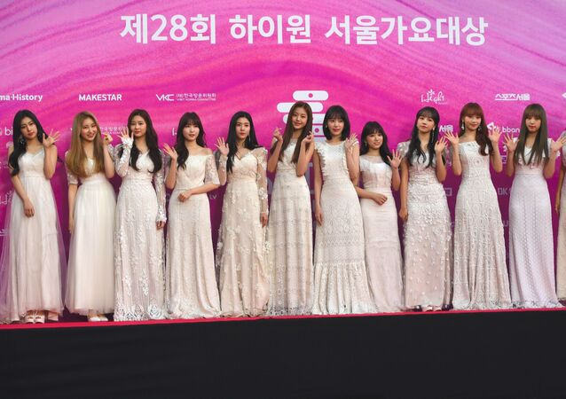 South Korean-Japanese girl group Iz One pose on the red carpet at the 28th Seoul Music Awards in Seoul on January 15, 2019