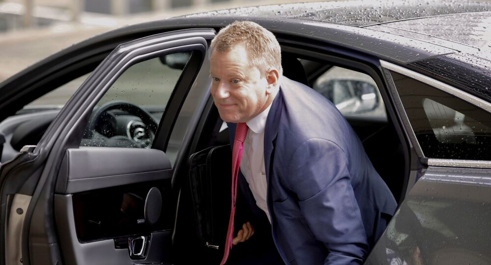 Britain's Brexit advisor David Frost arrives for a meeting with European Union chief Brexit negotiator Michel Barnier at EU headquarters in Brussels, Wednesday, Oct. 2, 2019