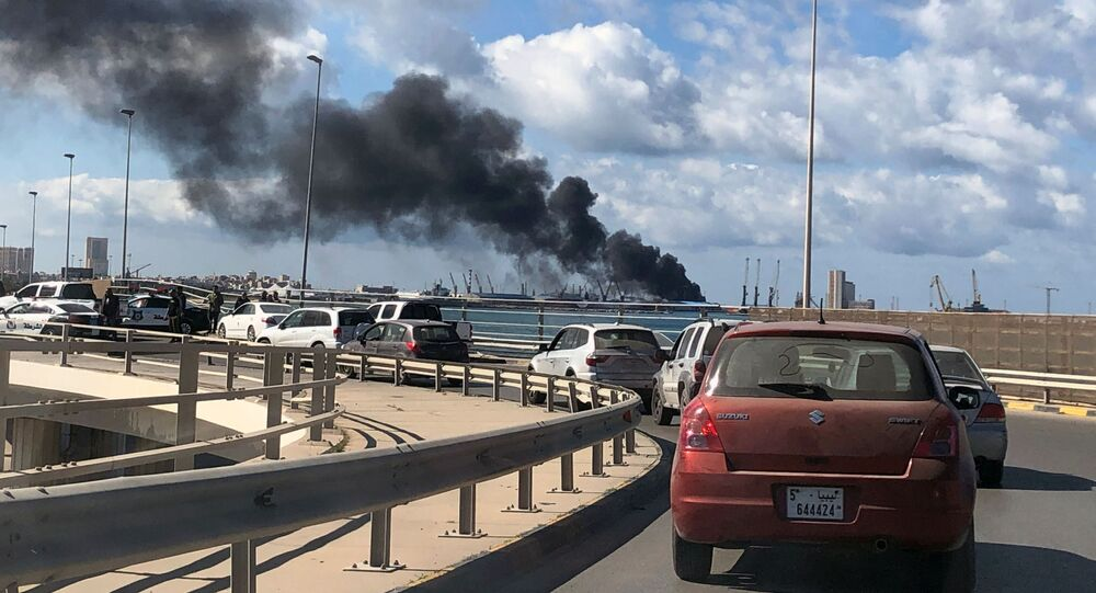 A cloud of smoke rises from the port of Tripoli after an attack in Libya on 18 February 2020