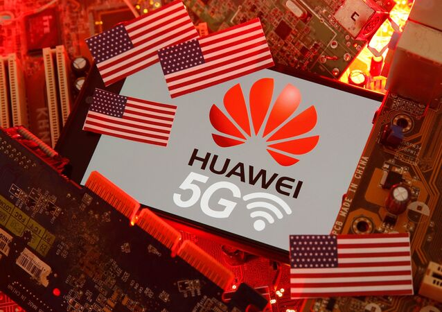 The US flag and a smartphone with the Huawei and 5G network logo are seen on a PC motherboard in this illustration, taken 29 January 2020