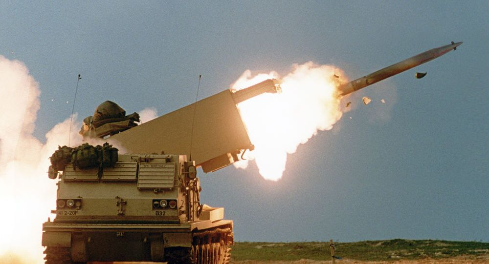 MLRS fires a Guided Multiple Launch Rocket System rocket.
