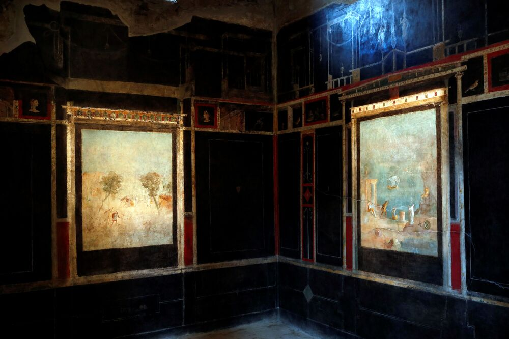 Frescos are pictured inside  the House of Orchard Casa del Frutteto, one of three restored domus (ancient houses) reopened to the public at the archaeological site of Pompeii, Italy, 18 February 2020.