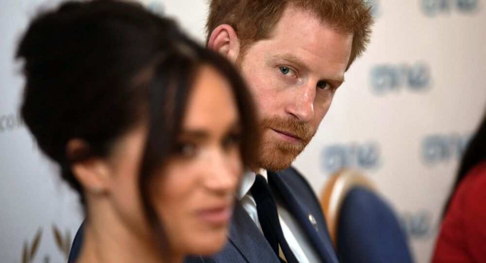 Britain's Prince Harry and Meghan Duchess of Sussex attend a roundtable discussion on gender equality at Windsor Castle in Windsor