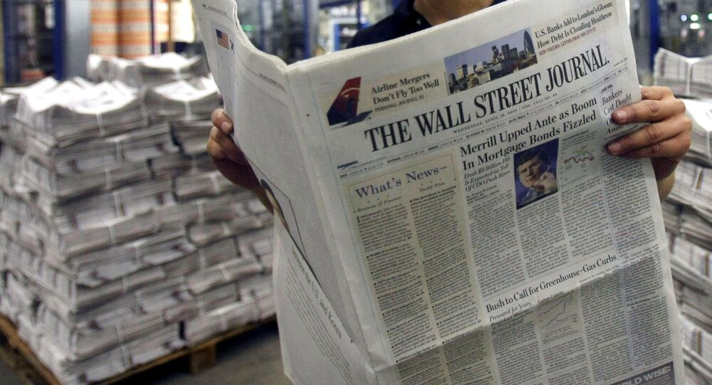 ** FILE ** In this April 16, 2008 file photo, printer Belinda Affat poses for photographs with a copy of the Wall Street Journal at a printing press in London.  A year into its takeover by Rupert Murdoch's News Corp., The Wall Street Journal is evolving under what its new editor calls incremental radicalism.  Steeped in tradition, the 119-year-old newspaper has expanded its coverage beyond corporate America, placed more breaking stories on the front page and increased the size of photos and graphics. (AP Photo/Matt Dunham, file)