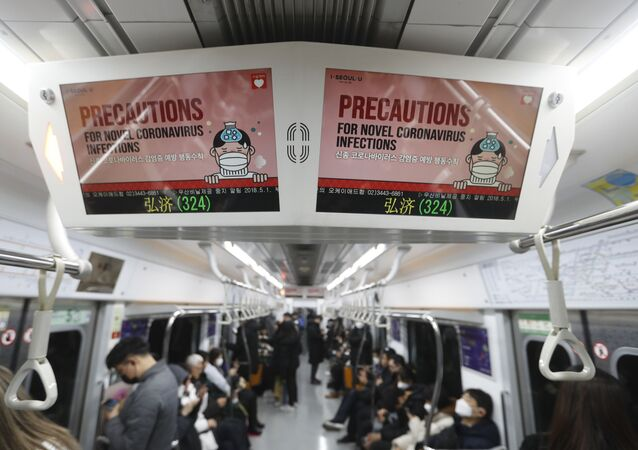 Electric screens about precautions against the illness COVID-19 are seen in a subway train in Seoul, South Korea, Monday, Feb. 17, 2020. Chinese authorities on Monday reported a slight upturn in new virus cases and 105 more deaths for a total of 1,770 since the outbreak began two months ago