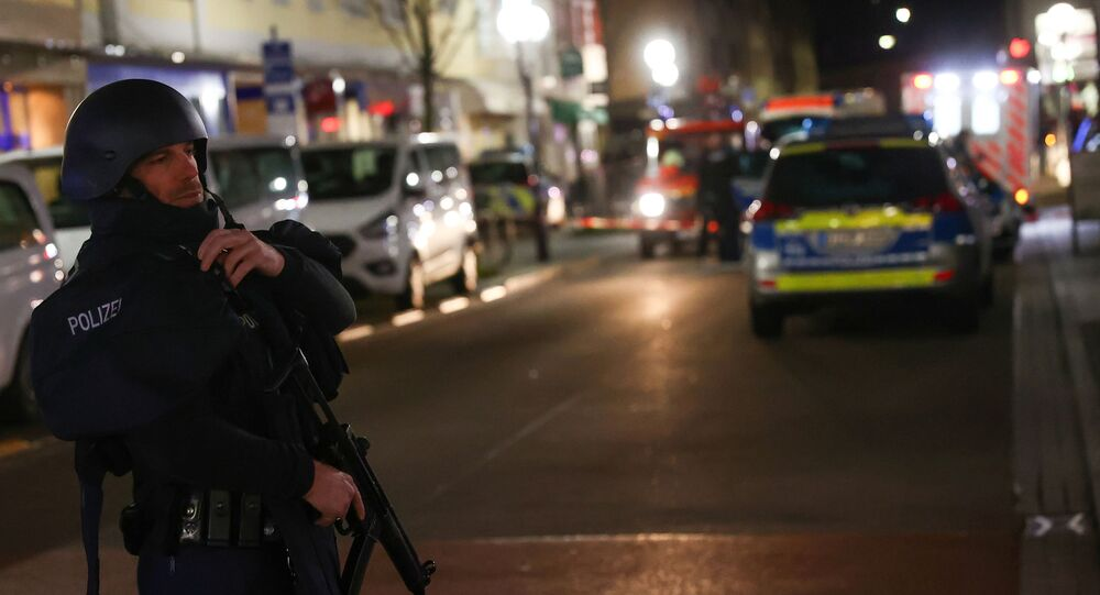 A police officer secures the area after a shooting in Hanau near Frankfurt, Germany, February 19, 2020