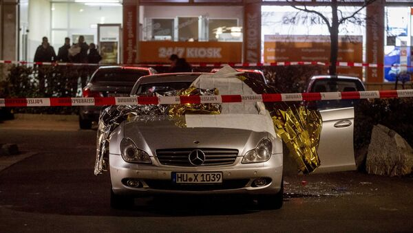A car with dead bodies stands in front of a bar in Hanua, Germany Thursday, Feb. 20, 2020. German police say several people were shot to death in the city of Hanau on Wednesday evening - Sputnik International